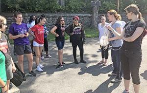 Girls standing around instructor