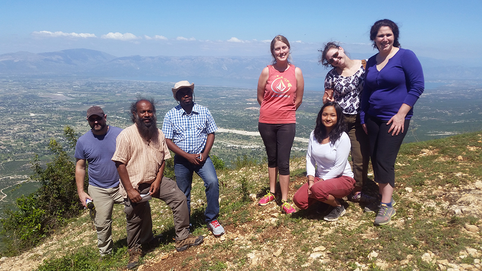 Jude Fernando and his students on a mountainside in Haiti
