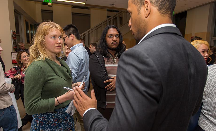 alumni members talking business in hall