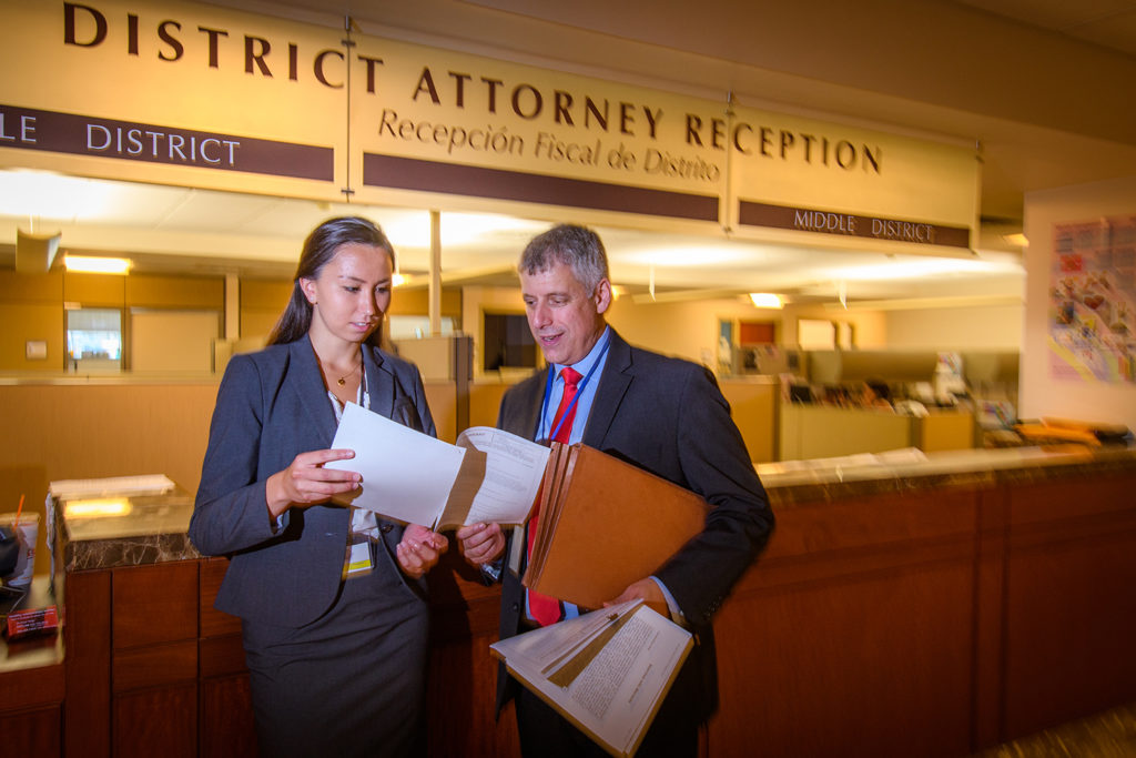 Rachael Chen talks to a prosecutor in the District Attorney's office