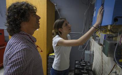 Megan McIntyre and Professor Chuck Agosta looking at instruments