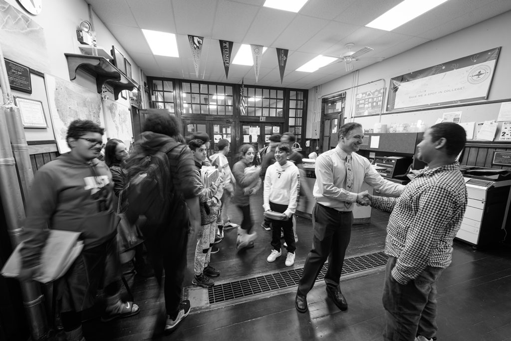 Students at University Park Campus School arrive for the day