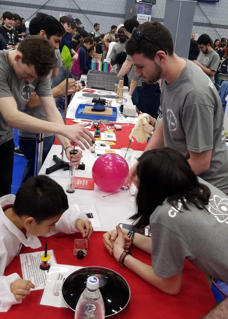 Physics students conduct experiments with Cambridge Science Festival attendees.