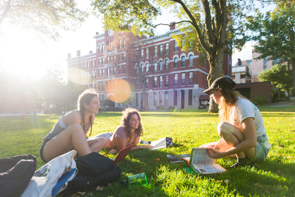 Students on the Clark University campus green