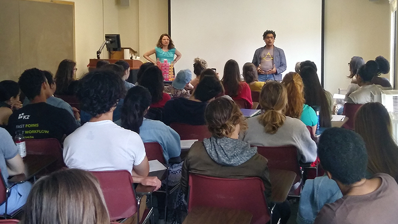 Dominican poet Leonardo Nin speaks before a crowded room of students during a classroom visit in Estabrook Hall.