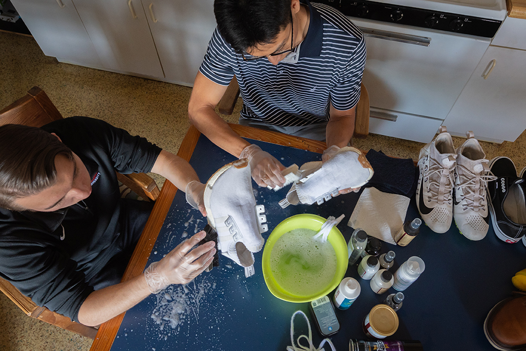 Trevor Tarnowski and Hector Miron Dominguez at work on cleaning shoes