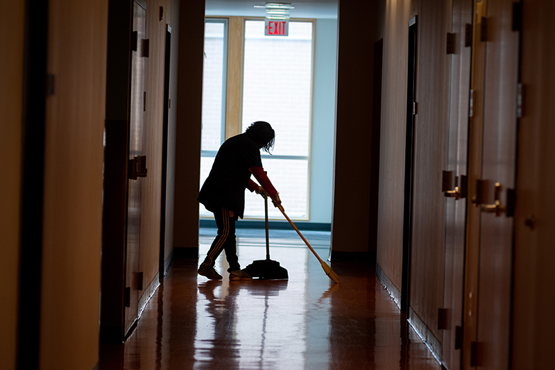 Facilities worker cleans Blackstone Hall