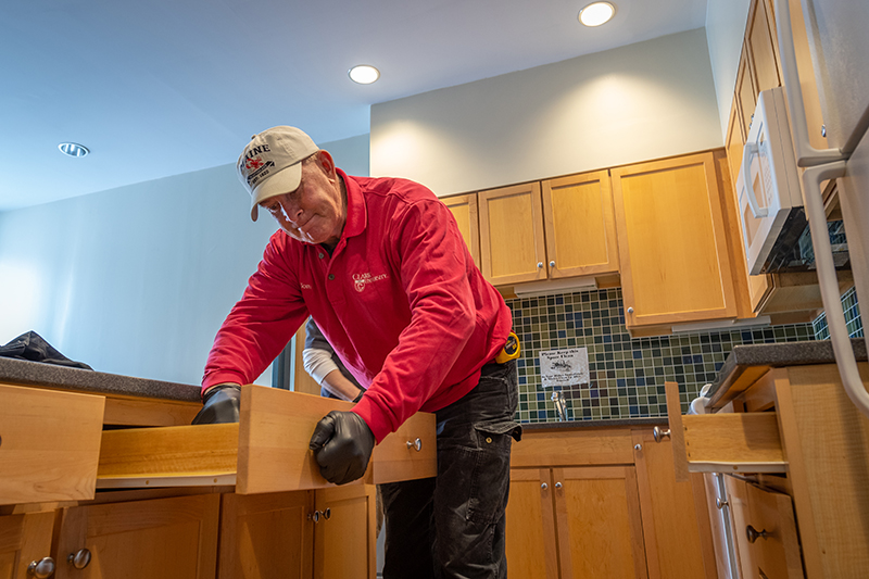 Facilities worker cleans a suite in Blackstone Hall