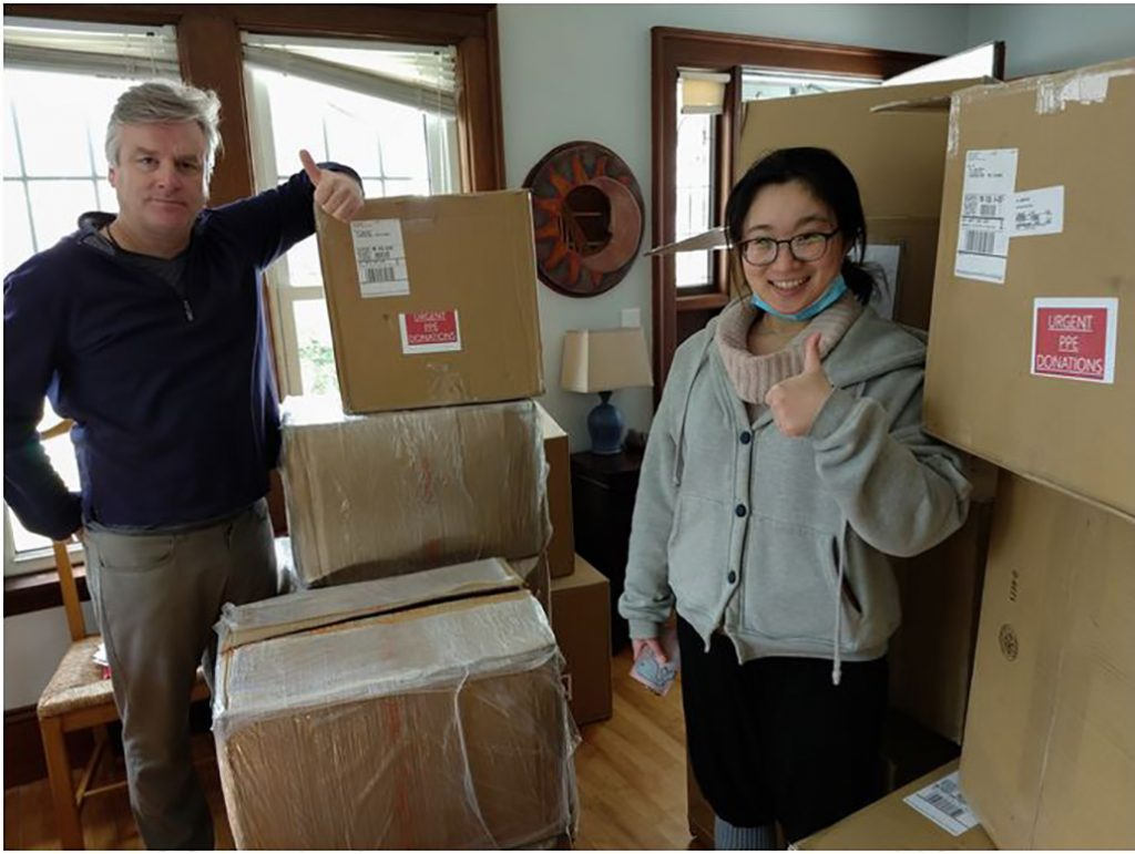 """John Dobson and Xinyang """"Yvonne"""" Li, MBA '21 with PPE secured from China"""