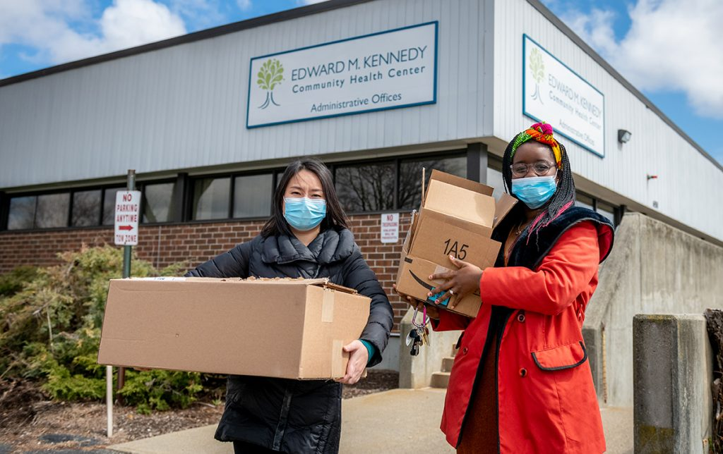 Yingying Chen, M.S. '11, and Bernadine MavHungu '14 brought donations of personal protective gear to a Worcester health center in the early days of the COVID-19 outbreak.