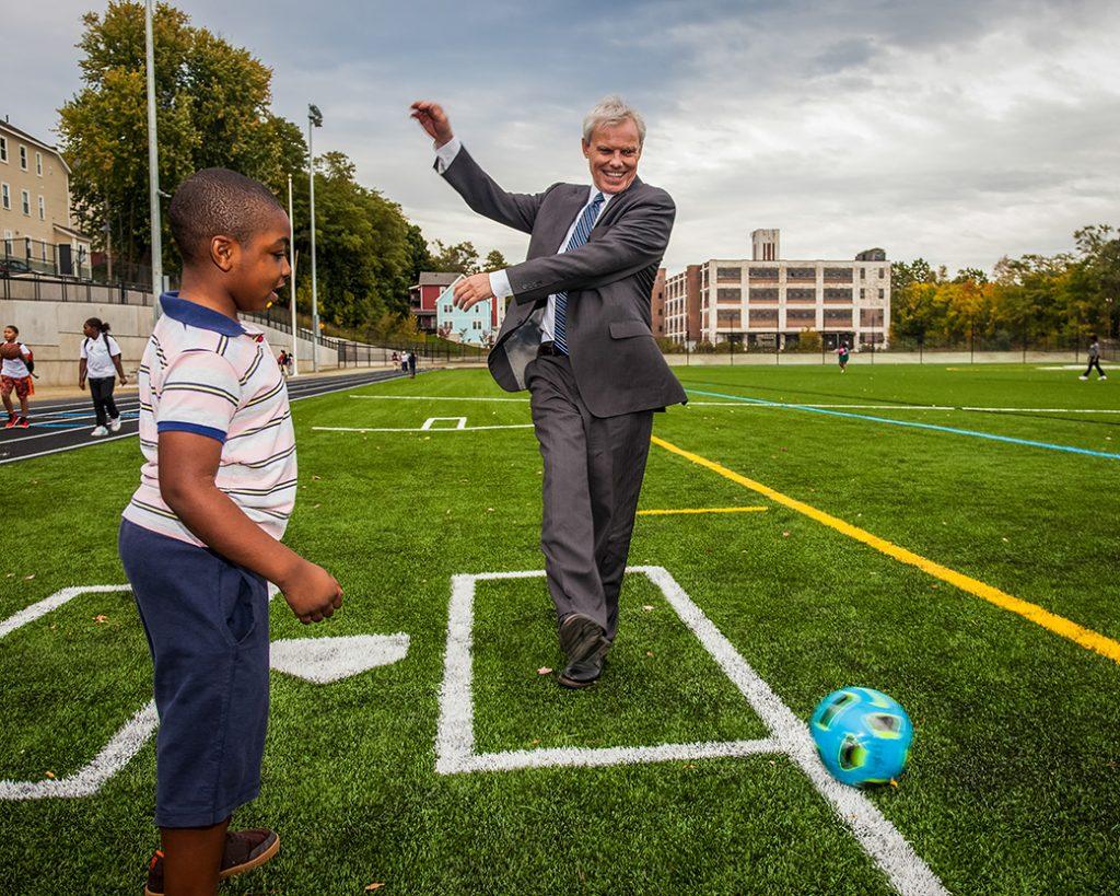 David Angel kicks a soccer ball